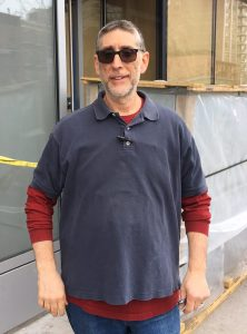 Co-owner David Wilpon stands outside the shop, then a construction zone, in March. Photo by Sabina Mollot)