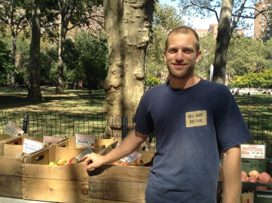 Lucas Samascott at his family farm's booth (Photo by Maya Rader)