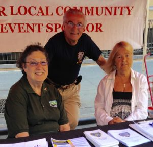 Carol Schachter, vice president of the 13th Precinct Community Council, pictured at right at a recent street fair that the Community Council sponsored, with a member, Pat Sallin, and its president, Frank Scala (Photo by Mary Mahoney)