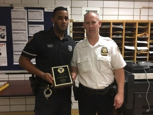 Cop of the Month Jeff Mayard with Deputy Inspector Brendan Timoney (Photo by Sabina Mollot)