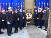 Fire officials and Christine Priore, daughter of a fallen fireman, at a wreath laying ceremony (ceremony photos by Sabina Mollot)