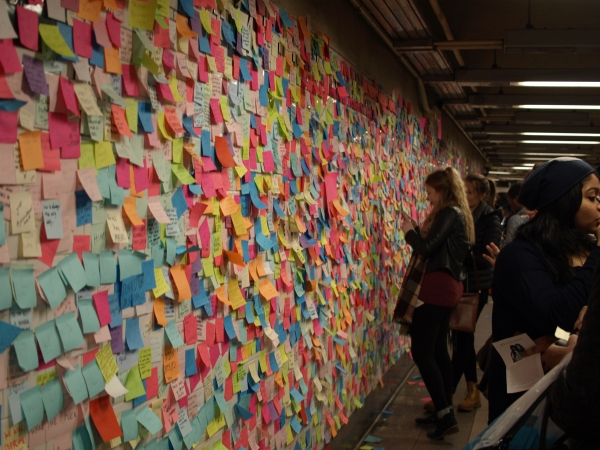 A wall of Post-it notes at the Union Square subway station followed a wall of Post-its put up at the14th Street station between  Sixth and Seventh Avenues. (Photos by Maria Rocha-Buschel)