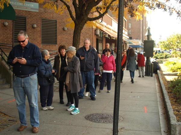 On Tuesday, a polling place at 360 First Avenue had a line spilling down the block. Many voters who spoke with T&V said they were supporting Hillary Clinton and local Democratic elected officials easily won reelection. (Photo by Maria Rocha-Buschel)