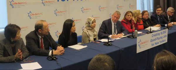 Mayor Bill de Blasio with other elected officials and speakers at an announcement at the Alexandria Science Research Center in Kips Bay. (Pictured) Dr. Vicki Sato, Dr. Harold Varmus, President of the Economic Development Corporation Maria Torres-Springer, Teeba Jihad, Mayor Bill de Blasio, City Council Speaker Melissa Mark-Viverito, Congresswoman Carolyn Maloney, State Senator Liz Krueger, State Senator Brad Hoylman and Assembly Member Brian Kavanagh (Photo by Michelle Deal Winfield)