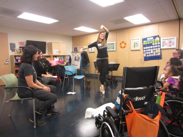 Ballet dancer Savannah Lowery gives a demonstration of how ballet steps can be adapted to upper body movements to children at NYU's Rusk Rehabilitation Center.
