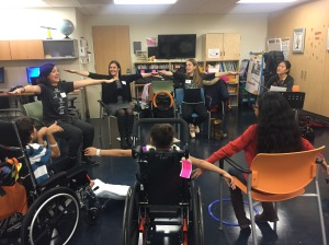 Patients confined to wheelchairs participate in a movement workshop led by Lowery.