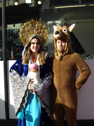 Eliza, dressed as the Virgin Mary, and her boyfriend Derek the reindeer participated in their 8th SantaCon this year.