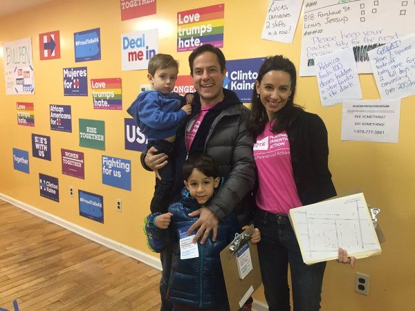 Zoe Segal-Reichlin, senior associate general counsel/director of advocacy and political law for the Planned Parenthood Federation of America, pictured in November with her husband, Council Member Dan Garodnick, and their two sons, Devin and Asher, as they door-knocked for Hillary Clinton (Photo courtesy of Dan Garodnick)
