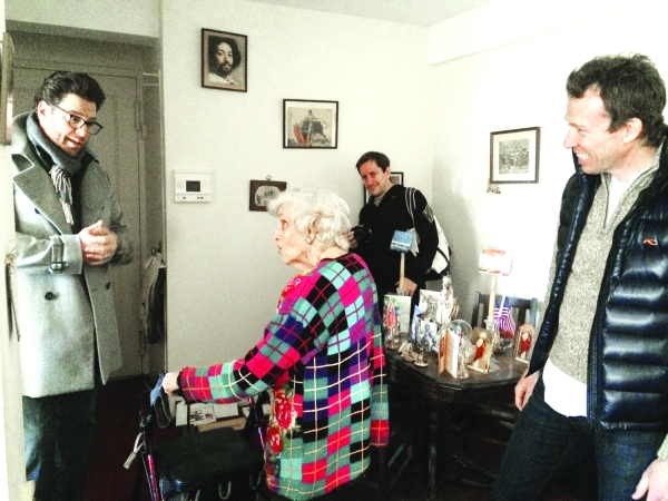 Mary Petrone, a Citymeals recipient pictured in 2014 during a visit from two chefs, Scott Conant of Scarpetta (left) and Ryan Hardy of Charlie Bird (right) (Photo by Sabina Mollot)
