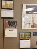 A calendar with a resident's artwork and an issue of the newsletter In the Loop