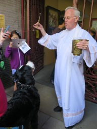 He may already be a Saint Bernard but this pooch leaves ICC just a little bit holier after getting blessed by Father Felix Jimenez.