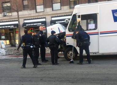 Police on Second Avenue attempt to free Melanie. Photos by Ted Weiner)