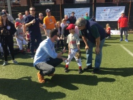 Jerry Blevins gets ready to throw the first pitch of the season to Vincent Ourvan, pictured with his father, former PSLL President Jeff Ourvan.
