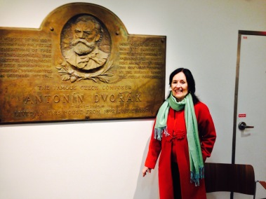 Rosalee Isaly with a plaque from Dvorak's former home