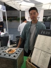 Co-owner Brian Ghaw of Feast on East 13th Street, serving an Asian-infused arroz con pollo,