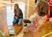 Students race remote controlled Battle Bots. (Photo by Ashley Naomi)