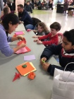 Mae Herzog, Alexander Brannen and Shariyaan Lal make origami creations with instructor Lisa Liu.
