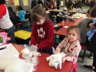Sisters Vicky and Chloe make stuffed animals with Bear Magic Workshop.